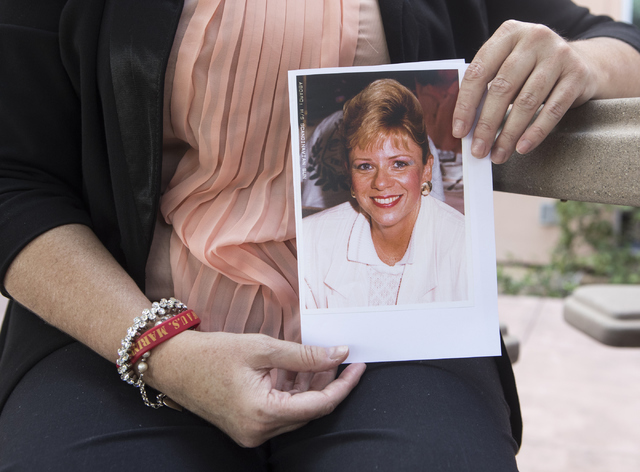 Michelle Perkins, daughter of Jan Sites, holds up a picture of her mother outside the Nevada Parole Board office in Las Vegas on Wednesday, Sept. 21, 2016. Sites was murdered by her husband, Willi ...