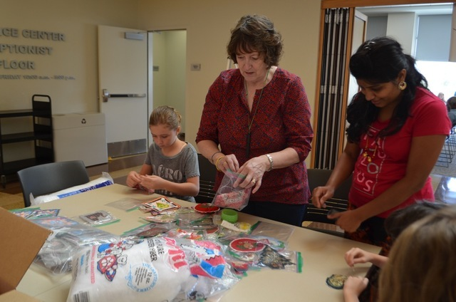 American Sewing Guild Las Vegas Chapter president Marti Wynn, center helps participants work on an ornament project during a Sit 'n' Sew day Sept. 2 at Windmill Library, 7060 W. Windmill Lane. ...