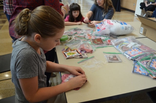 Nevada Coffran, 10, sews an ornament during an American Sewing Guild Sit 'n' Sew day Sept. 2 at Windmill Library, 7060 W. Windmill Lane. Ginger Meurer/View