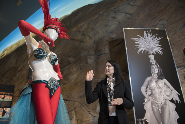 """Summerlin-area resident Karan Feder, guest curator of costumes and textiles at the Nevada State Museum, explains the history of stage costumes from """"The Les Folies Bergere"""" exhibit at the museum i ..."""