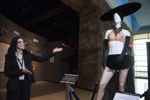 Karan Feder, guest curator of costumes and textiles at the Nevada State Museum, explains the history of stage costumes Aug. 27. Martin S. Fuentes/View