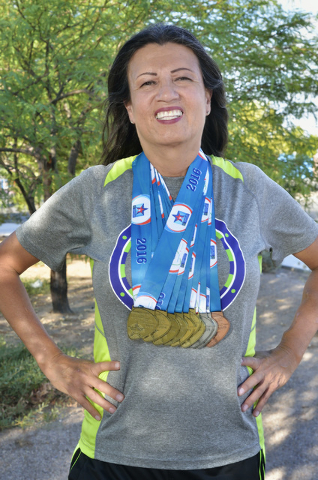 Dinorah Arambula is shown at the Kellogg Zaher Soccer Complex at 7901 W. Washington Ave. in Las Vegas on Thursday, Sept. 1, 2016 with some of the medals sheճ won from running events in trans ...