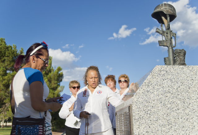 """Henderson resident Marina Vance, left, looks at a monument during a memorial service for her son, the late U.S. Army Spc. Ignacio """"Nacho"""" Ramirez, at the Southern Nevada Veterans Memorial Cemetery ..."""