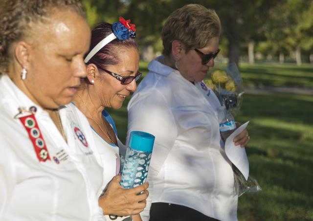 "Marina Vance, center, walks during a memorial service for her son, the late U.S. Army Spc. Ignacio ""Nacho"" Ramirez, at the Southern Nevada Veterans Memorial Cemetery in Boulder City Aug. 9. Daniel ..."
