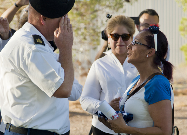 """Marina Vance, right, receives a flag from Command Sgt. Maj. Robert Brown during a memorial service for her son, the late U.S. Army Spc. Ignacio """"Nacho"""" Ramirez, at the Southern Nevada Veterans Mem ..."""