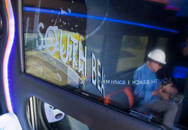 Bob Schulman is reflected in the on-board television inside a Mercedes-Benz van parked at the future site of the South Beach luxury apartment complex in Las Vegas on Thursday, Sept. 8, 2016. Danie ...