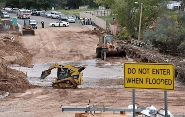 Clean-up in Hildale, Utah, after a flash flood killed 12 in the community on the Utah-Arizona border, Sept. 15, 2015.