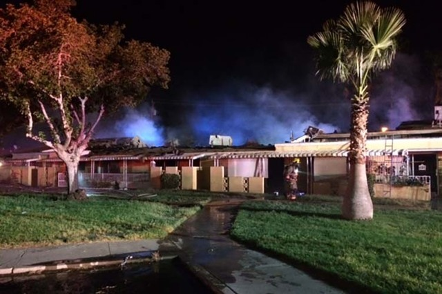 Twenty people were displaced after a fire heavily damaged eight apartments at Paradise Spa Apartments, 9457 Las Vegas Blvd. South, late Tuesday night, Sept. 6, 2016. (Clark County Fire Department)
