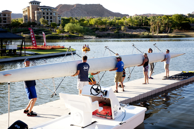Lake Las Vegas Rowing Club members prepare to launch their racing shell for a practice run at Lake Las Vegas in Henderson on Thursday, Sept. 8, 2016. (Jeferson Applegate/Las Vegas Review-Journal)