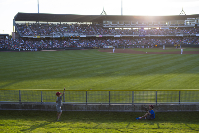 Children play catch as a baseball game goes on between the Salt Lake Bees and Las Vegas 51s at Smith's Ballpark in Salt Lake City on Monday, June 20, 2016. (Chase Stevens/Las Vegas Review-Journal) ...