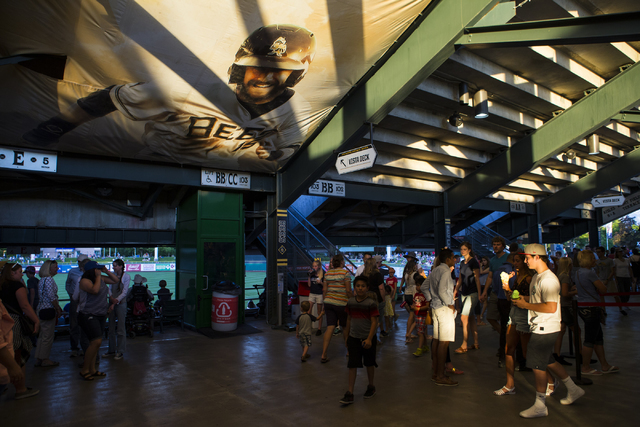 People arrive for a baseball game between the Salt Lake Bees and Las Vegas 51s at Smith's Ballpark in Salt Lake City on Monday, June 20, 2016.  (Chase Stevens/Las Vegas Review-Journal) Follow @css ...