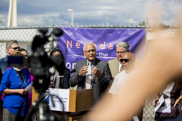"Charles Redmon, member of University United Methodist Church, speaks on behalf of Nevadans for the Common Good regarding their ""Seven Hidden Risks in the Stadium Plan"" outside of ..."