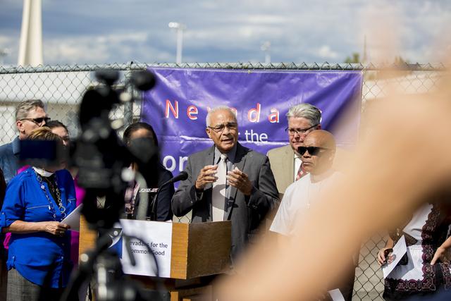 """Charles Redmon, member of University United Methodist Church, speaks on behalf of Nevadans for the Common Good regarding their """"Seven Hidden Risks in the Stadium Plan"""" outside of ..."""
