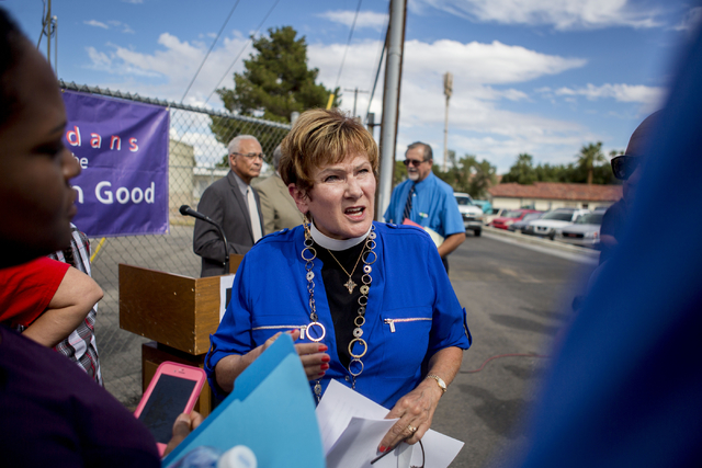 "Reverend Dr. Marta Poling Schmitt speaks on behalf of Nevadans for the Common Good regarding their ""Seven Hidden Risks in the Stadium Plan"" outside of the organization's office,  ..."