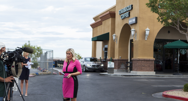 A television news reporter stands outside of Starbucks at 7260 S. Rainbow Blvd. in Las Vegas on Tuesday, Sept. 27, 2016. A fatal shooting broke out inside the coffee shop on Sunday, Sept. 25, 2016 ...