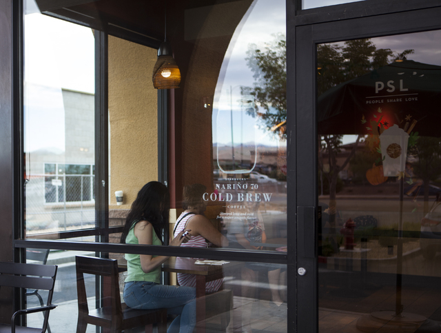 Patrons sit inside Starbucks at 7260 S. Rainbow Blvd. in Las Vegas on Tuesday, Sept. 27, 2016. A fatal shooting broke out inside the coffee shop on Sunday, Sept. 25, 2016. Miranda Alam/Las Vegas R ...