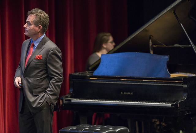 UNLV President Len Jessup watches a video on campus life during his second state of the university address at the Judy Bayley Theatre at UNLV on Thursday, Sept. 15, 2016. Benjamin Hager/Las Vegas  ...