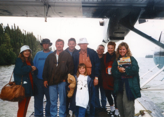 """The Winters family on a fishing trip to Canada in 1998. Susan Winters' husband, Gregory """"Brent"""" Dennis, is fourth from the left. Susan Winters is second from the right. Courtesy Avis Winters."""