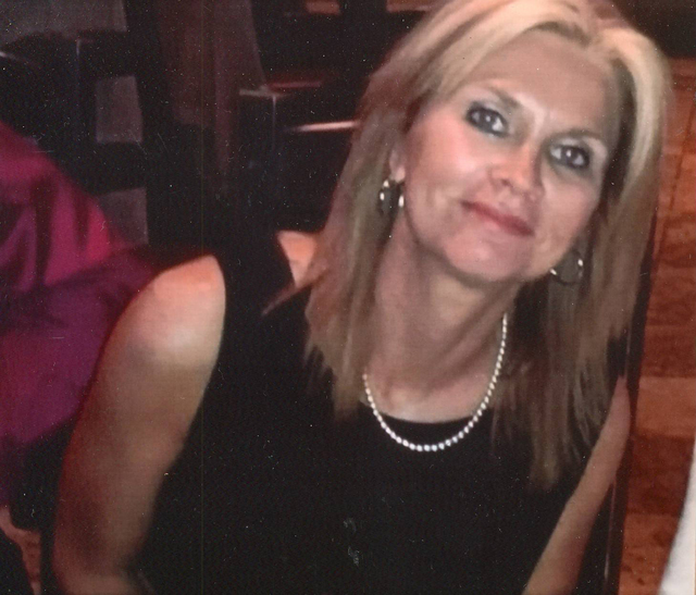 Susan Winters is shown at a wedding rehearsal dinner for her niece in 2014. (Avis Winters)