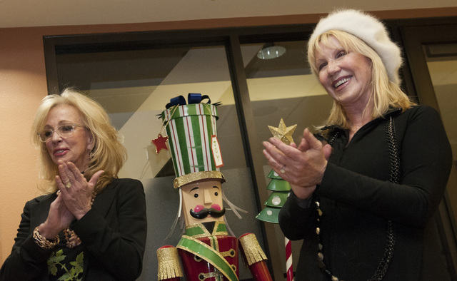 Former Las Vegas Mayor Jan Jones Blackhurst and Linda Smith of Opportunity Village attend a ribbon-cutting ceremony of a new board room sponsored by Caesars Foundation at Opportunity Village on Tu ...