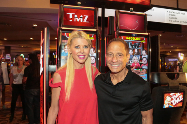 Tara Reid and TMZ chief Harvey Levin at the Aug. 29 launch of TMZ slots at the Hard Rock Hotel. (Edison Graf for Kabik Photo Group)