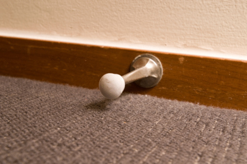 THINKSTOCK A doorstop will prevent the door from hitting the wall.
