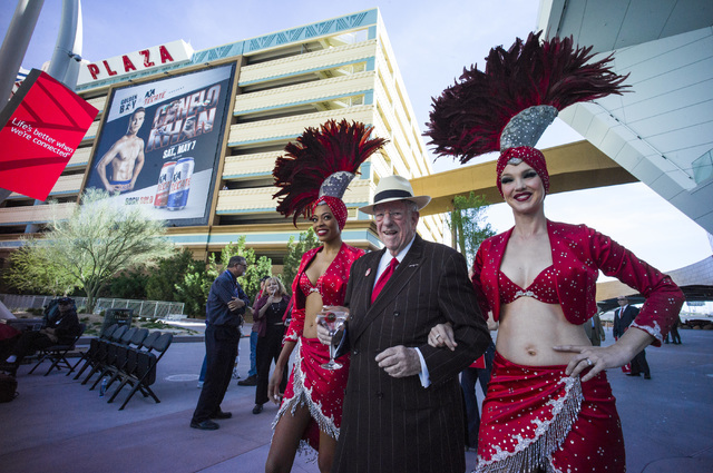 Oscar Goodman, with showgirls Trisha Thompson, left, and Kristina Schiavi for a rally celebrating National Travel & Tourism Week at Toshiba Plaza in Las Vegas on Tuesday, May 3, 2016. Chase St ...