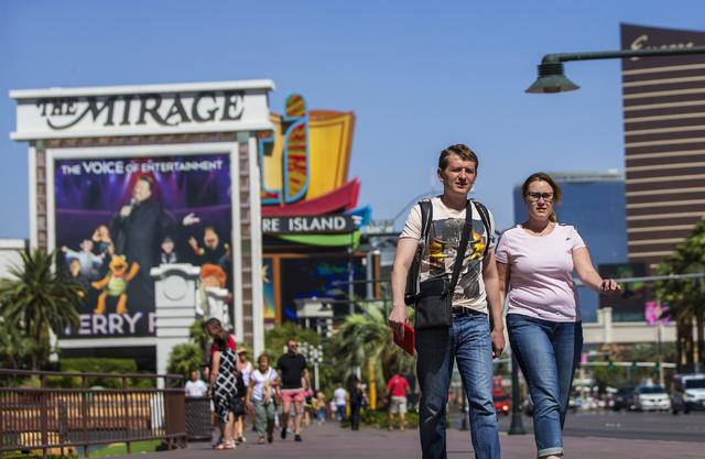 Tourists Artem Sorokin, left, and wife Anna walk the Las Vegas Strip on Thursday, Sept. 22, 2016, in Las Vegas. Benjamin Hager/Las Vegas Review-Journal