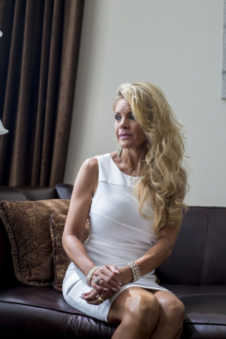 Tracy Rodgers, previous Ms. Nevada State America title holder and current contestant, discusses her accident during an interview with Las Vegas Review-Journal Reporter, Paul Harasim, left, in her  ...