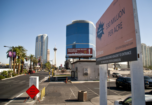 A sign advertises a 5.5 acre lot for sale near the site where the Riviera hotel-casino once stood in Las Vegas on Friday, Sept. 23, 2016. The sellers are asking for $30 million per acre. Daniel Cl ...