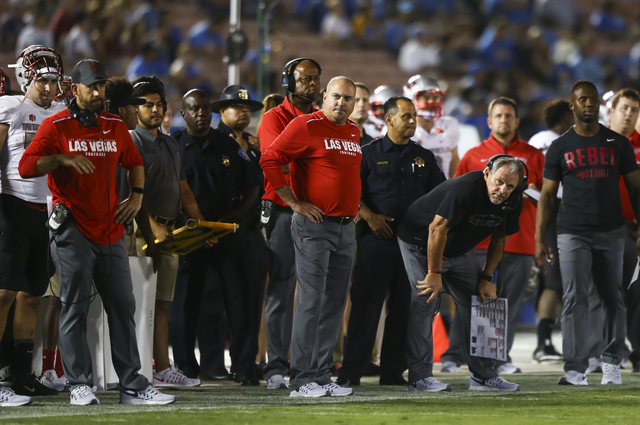 UNLV Rebels head coach Tony Sanchez, center, looks on as his team plays UCLA during a football game at the Rose Bowl in Pasadena, Calif. on Saturday, Sept. 10, 2016. UCLA won 42-21. (Chase Stevens ...