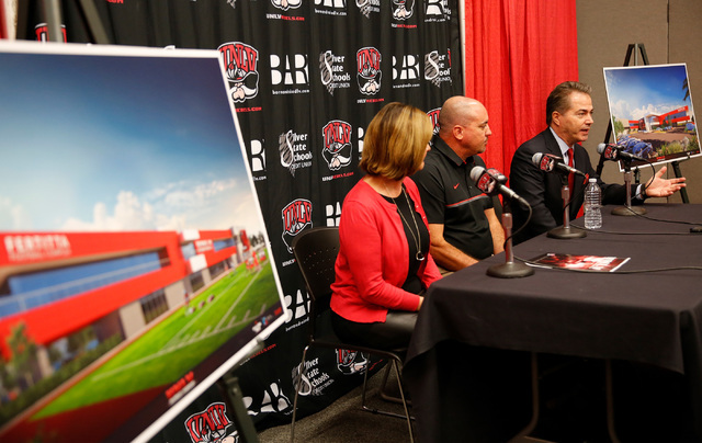 UNLV President Len Jessup, right, speaks during a news conference in Las Vegas, Tuesday, Sept.13, 2016, as Athletics Director Tina Kunzer-Murphy and Coach Tony Sanchez look on. UNLV announced the  ...
