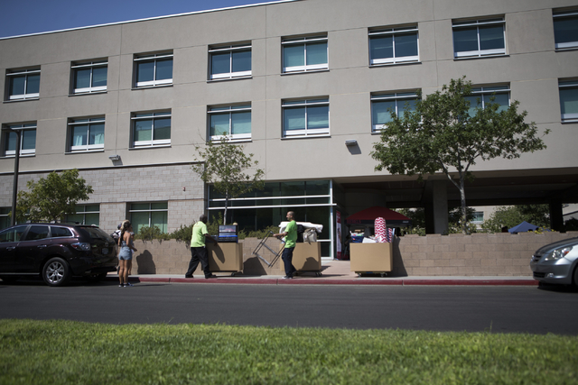 Movers assist students with their belongings outside of UNLV's Daytons Complex during move-in day on Wednesday, Aug. 24, 2016, in Las Vegas. (Erik Verduzco/Las Vegas Review-Journal Follow @Erik_Ve ...