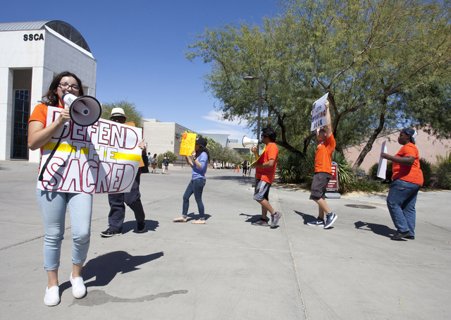 Isabelle Varela, left and the other NextGen Climate protesters gather outside of University of Nevada, Las Vegas to stand in solidarity with Standing Rock Sioux tribe on Tuesday, Sept. 13, 2016. ( ...