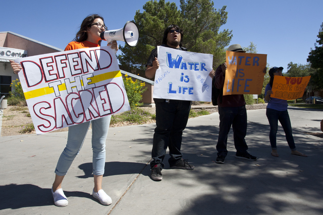 Protesters from NextGen Climate Isabelle Varela, left and Manuel Ayala gather outside of University of Nevada, Las Vegas to stand in solidarity with Standing Rock Sioux tribe on Tuesday, Sept. 13, ...