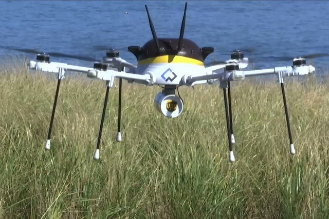 In this still image from video, a test drone making a UPS delivery lands on Children's Island in Marblehead, Mass., Thursday, Sept. 22, 2016. (Rodrique Ngowi/AP)