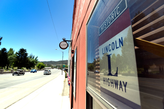 A Lincoln Highway sign is seen posted in a store front along the main street in Ely, Nev. Monday, July 11, 2016. The Lincoln Highway was one of the earliest transcontinental highways and is now du ...