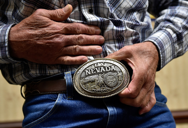 "Ed Spear, tourism director for White Pine County shows off his custom belt buckle Monday, July 11, 2016, in Ely, Nev. Spear said that the state's ""Loneliest Road"" promotion is one of the best, and ..."