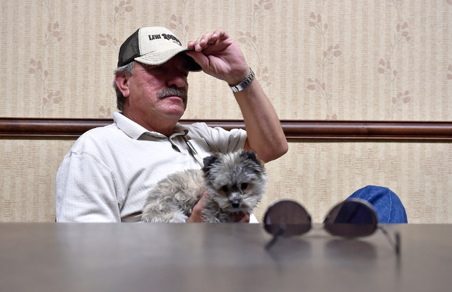 "Ely resident Ferrel Hansen with dog Daisy speaks about U.S. Highway 50 Monday, July 11, 2016, in Ely, Nev. Ferrel said that the state turned ""lemons into lemonade"" after Life magazine referred to  ..."