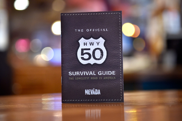 A U.S. Highway 50 survival guide passport is displayed at the Hotel Nevada Monday, July 11, 2016, in Ely, Nev. The state created the tourism program by engaging motorists to visit and stop after L ...