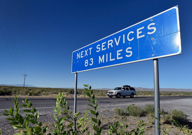 A roadside sign seen along U.S. Highway 50 Monday, July 11, 2016 alerts motorist along the Nevada/Utah state line that the next services are a ways away. The State of Nevada created a tourism prog ...