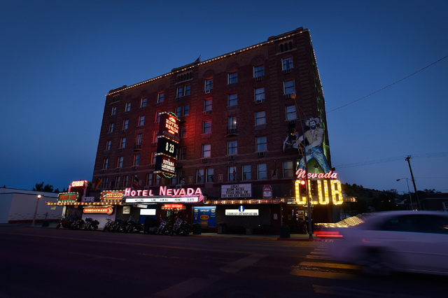 "The Hotel Nevada stands tall along U.S. Highway 50 in Ely, Nev. The six-story hotel built in 1929, is a regular stop for tourists participating in Nevada's ""Loneliest Road"" program. (David Becker/ ..."