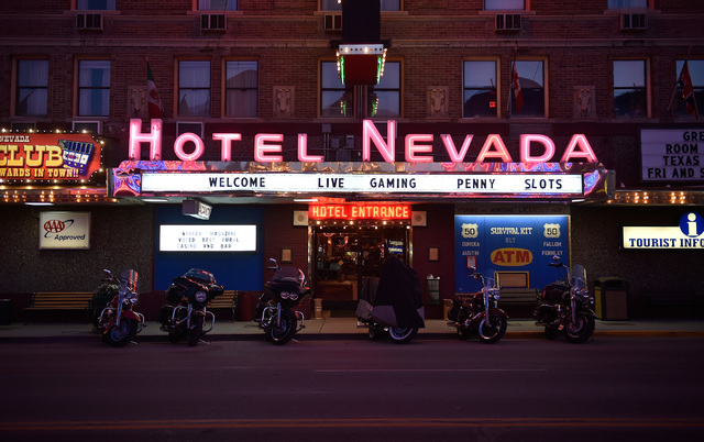 "Motorcycles are awash in neon light from the Hotel Nevada along U.S. Highway 50 in Ely, Nev. The six-story hotel built in 1929, is a regular stop for tourists participating in Nevada's ""Loneliest  ..."
