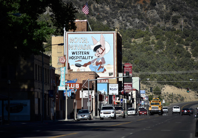 "A mural covering the Hotel Nevada along U.S. Highway 50 welcome motorists in Ely, Nev. The six-story hotel built in 1929, is a regular stop for tourists participating in Nevada's ""Loneliest Road""  ..."
