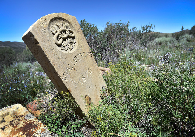A grave headstone is seen in the historic mining town of Hamilton, about 10 miles south of U.S. Highway 50 Tuesday, July 12, 2016. Tourism officials for Nevada created a program for motorists to v ...