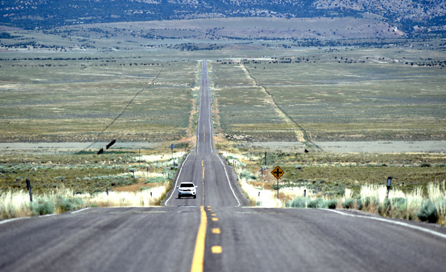 A motorist travels along U.S. Highway 50 in western White Pine County Tuesday, July 12, 2016. The state of Nevada created a tourism program for motorists to visit and stop along Highway 50 after L ...