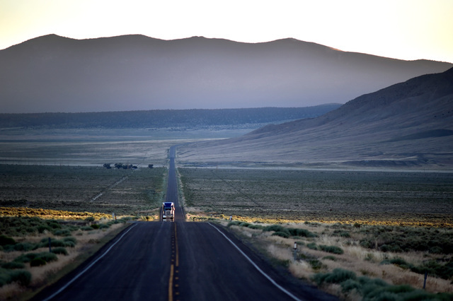 A truck, lite by the last bit of light, travels along U.S. Highway 50 in western White Pine County Tuesday, July 12, 2016. The state of Nevada created a tourism program for motorists to visit and  ...