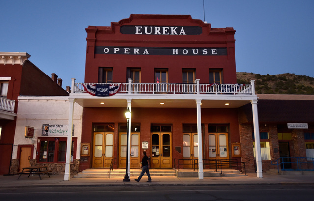 A man walks by the Eureka Opera House along U.S. Highway 50 on Tuesday, July 12, 2016, in Eureka, Nev. The state of Nevada created a tourism program for motorists to visit places like the 1880 the ...