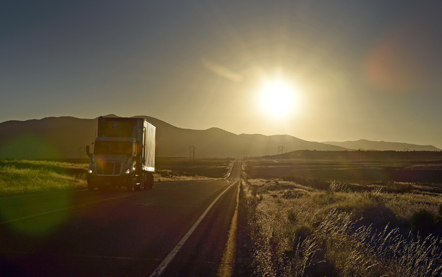 "A truck travels along U.S. Highway 50 at sunrise west of Eureka, Nev. Wednesday, July 13, 2016. Since a 1986 Life magazine which dubbed the Nevada portion of the road  ""The Loneliest Road in Ameri ..."