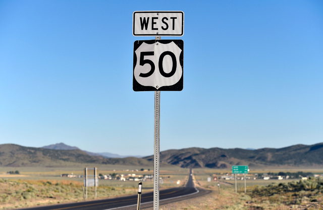 "A U.S. Highway 50 road sign is seen west of Eureka, Nev. Wednesday, July 13, 2016. Since a 1986 Life magazine which dubbed the Nevada portion of the road  ""The Loneliest Road in America,""  state t ..."